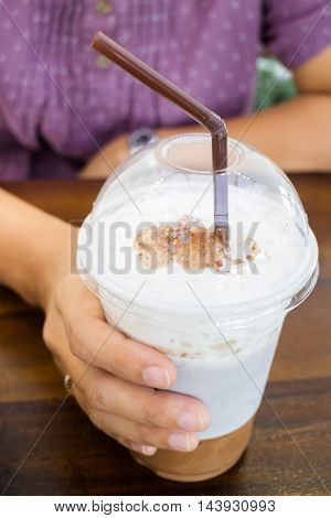 Woman hand holding iced coffee stock photo