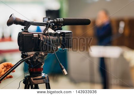 Television camera recording publicity event, toned image