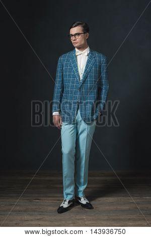 Retro 1920S Dandy Man Wearing Blue Checkered Jacket And Pants.