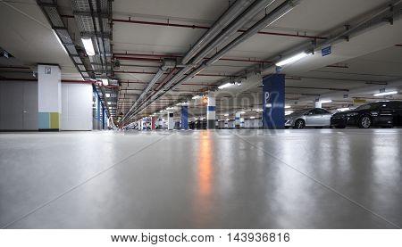 Illuminated parking garage low-angle view selective focus cars