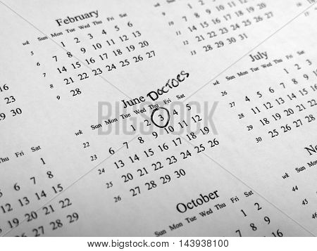 Generic calendar with doctors appointment circled with shallow depth of field centred on highlighted date