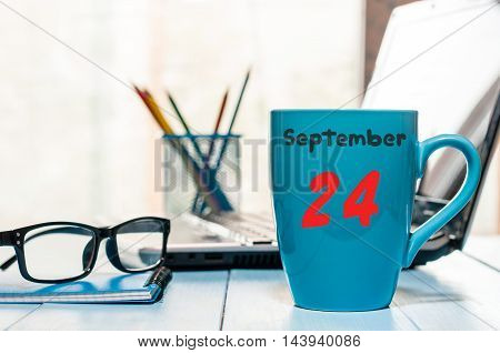 September 24th. Day 24 of month, calendar on Information Officer workplace background. Autumn time. Empty space for text.