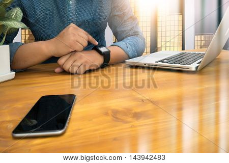 Cropped Shot Silhouette Of A Man's Hands Using A Laptop