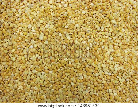 Dry peas. Background of halves dry peas. Dry peas background. Peas as background.