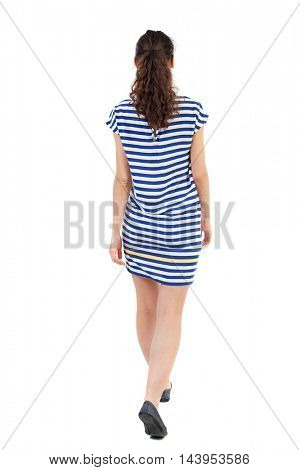 back view of walking  curly woman.  backside view of person.  Rear view people collection. Isolated over white background.Swarthy girl in a checkered slowly goes deeper into the frame.