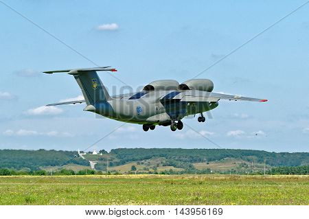 KHARKIV UKRAINE - AUGUST 20 2016: Antonov An-72 of Ukrainian National Guard takes off from a dirt runway at the airport Korotych Kharkov region Ukraine on August 20 2016
