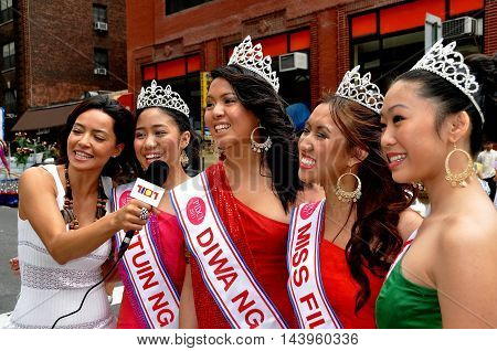 New York City - June 4 2011: Filippina beauty queens being interviewed at the annual Philippines Independence Day Parade on Madison Avenue