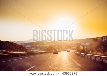 Malaga, Spain - June 20, 2015: The movement of vehicles on freeway, motorway E-15 near Malaga in Spain. Sunset time