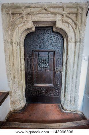 Metal door in Bran Castle known as Dracula's Castle near Bran in Romania
