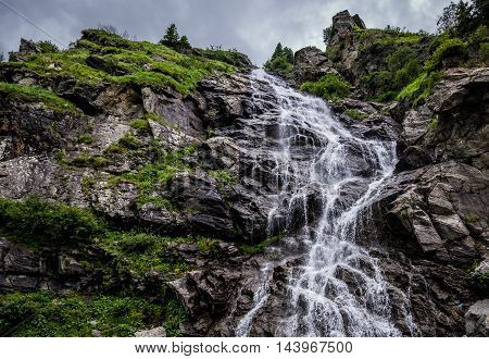 Capra Waterfall next to Transfagarasan Road in southern section of Carpathian Mountains in Romania