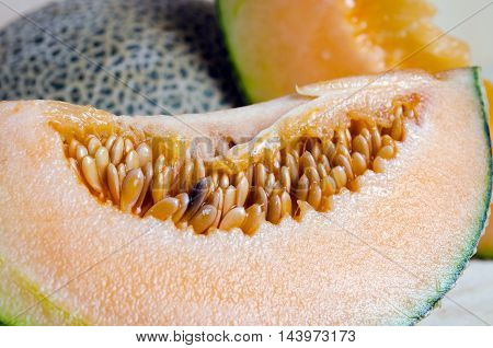 Sliced Melon With Seed On Wooden Board (other Names Are Cantelope, Cantaloup, Honeydew, Crenshaw, Ca