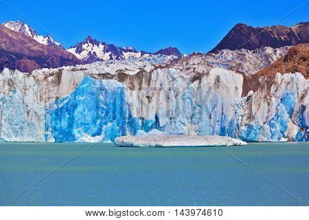Excursion by boat to the huge white-blue glacier. Unique lake Viedma in Argentine Patagonia. The lake is surrounded by mountains
