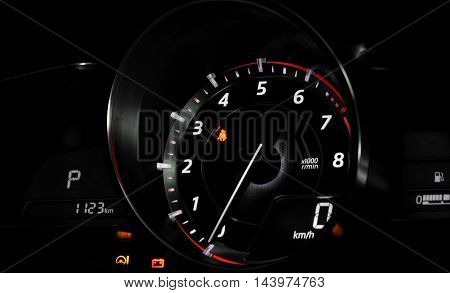 Tachometer showing zero revolutions per minute on the car dashboard