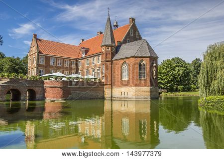 Burg Hulshoff With Reflection In The Water Near Havixbeck