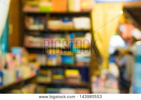 Blurred background of people read a book in library