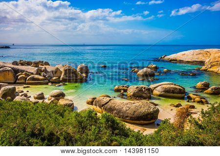 Huge boulders on the beach of the Atlantic Ocean. Boulders Penguin Colony in the Table Mountain National Park, South Africa. The concept of ecotourism
