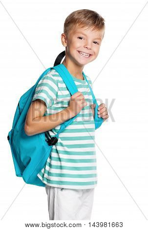 Cute teenager boy with backpack. Smiling schoolboy with bag isolated on white background. Portrait of happy child. Back to school.