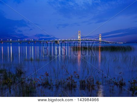 Seen From St Ignace in the upper peninsula at dusk the Mackinac Bridge spans the upper and lower peninsulas of Michigan USA