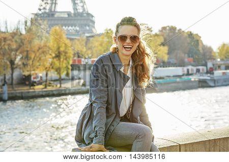Portrait Of Happy Elegant Woman Sitting On The Parapet N Paris