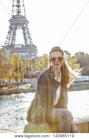 Portrait Of Elegant Woman Sitting On The Parapet In Paris, Franc