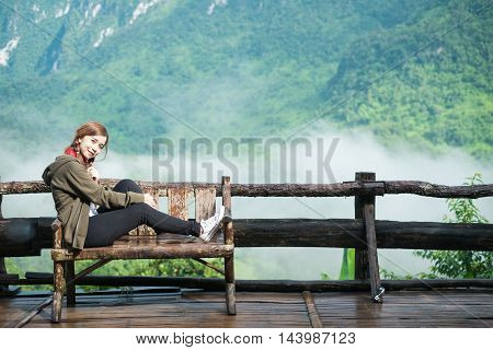Smiling Young Woman With  Montains Background ( Chiang Mai Province, Thailand )