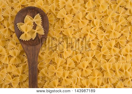 Farfalle (commonly known as Bow-Tie Pasta) on a wooden spoon