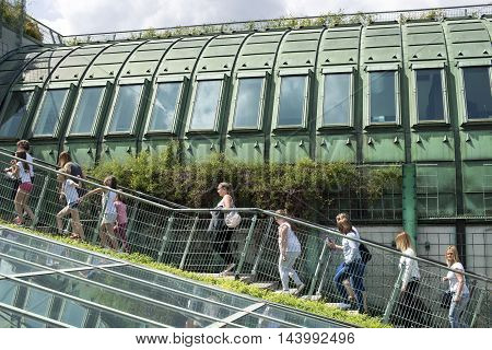 WARSAW - JUNE 12: many visitors ascending to the famous rooftop garden located on the roof of University Library building in Warsaw Poland on June 12 2016.