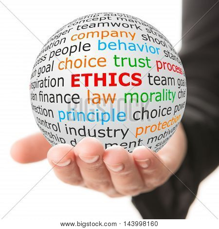 Ethics concept. Hand take white ball with wordcloud and ethics word in red color.