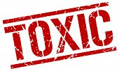 toxic stamp. red grunge square isolated sign poster