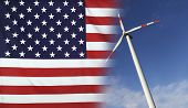 Concept clean energy with flag of USA merged with wind turbine in a blue sunny sky poster