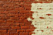 Texture of old brick wall surface. Bicolor wall. Old brick wall texture background poster
