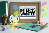 Interns wanted announcement message note on bulletin board in office poster