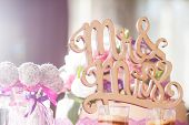 Wedding details. Mr and Mrs. Delicious wedding reception candy bar table. poster