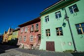 Old tenement house in Sighisoara town in Romania poster