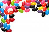 A border of colorful jelly beans, isolated on white. poster