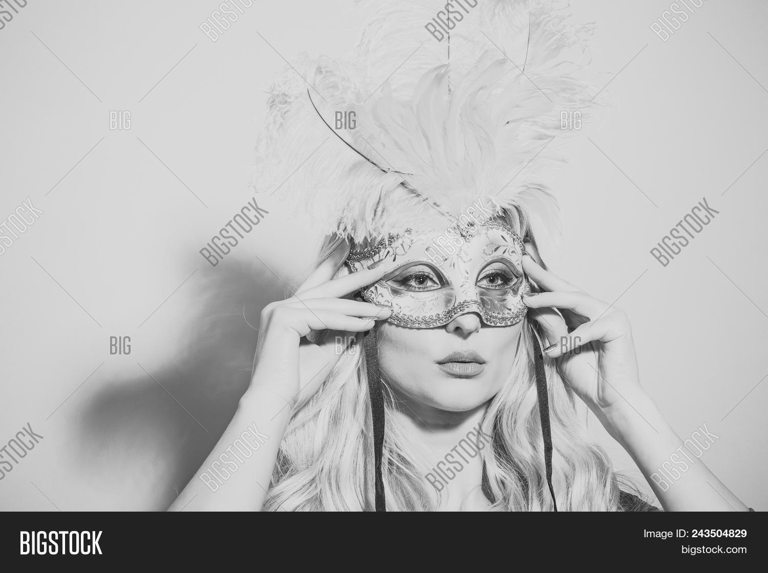 c97b85ab1ed Face girl for magazine cover. Girl face portrait in your advertisnent.  theatre and carnival party. Woman with long blond hair in carnival mask.  Beauty and ...
