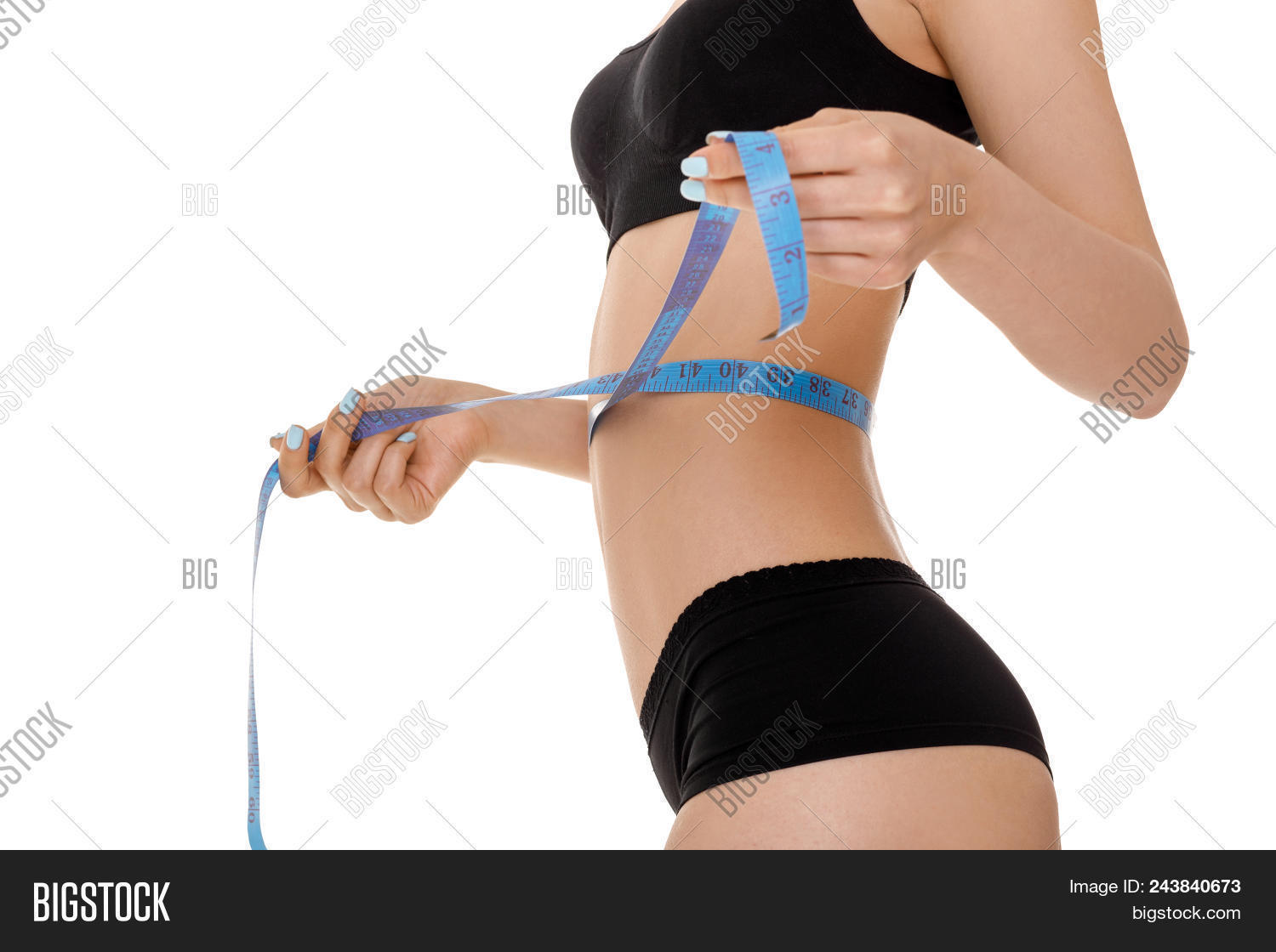 9510a1c1c2061 Woman Measuring Her Perfect Waist With Blue Measuring Tape. Slim Body On  White Background