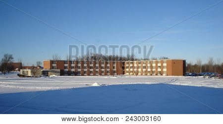 Whitney Hall In Winter Surrounded By Snow Under A Clear Blue Sky, Defiance College, Defiance, Oh, Ja
