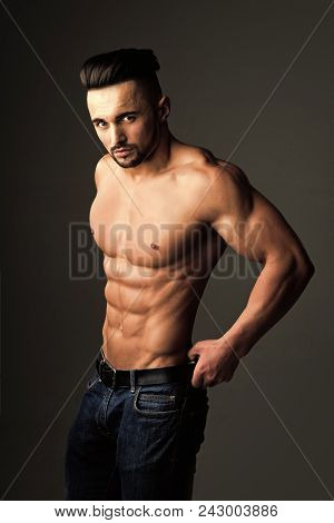 Handsome Man Face. Man With Muscular Body And Bare Chest Or Coach Sportsman In Jeans On Grey Backgro