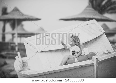 Kids Playing - Happy Game. Child Little Boy Little Sitting In Life Buoy On Boat. Small Kid Pointing