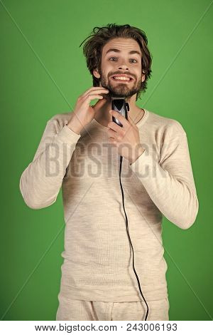 Man Face Handsome. Man Trimming Beard Hair With Electric Razor. Man With Disheveled Hair Grooming In