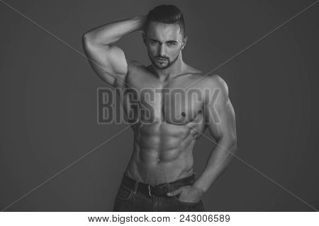 Mens Heals Body Care. Coach Sportsman With Bare Chest In Jeans. Man With Muscular Body And Torso. Sp