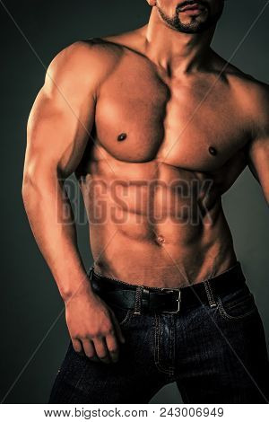 Mens Heals Body Care. Man With Muscular Body And Torso. Athletic Bodybuilder Man On Grey Background.