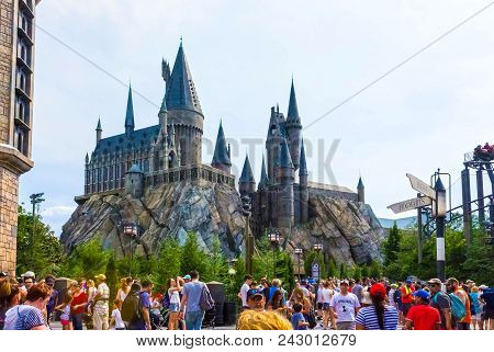 Orlando, Florida, Usa - May 09, 2018: The People Going Near Hogwarts Castle At The Wizarding World O
