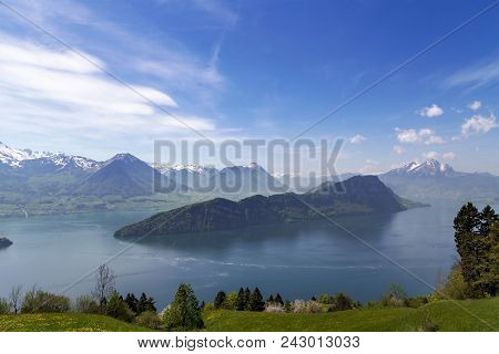 Landscape View Of Lucern Lake , Apls Mountain With Grass Flower In Spring Season
