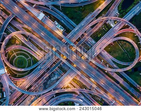 Top View Of Highway Road Junctions At Night. The Intersecting Freeway Road Overpass The Eastern Oute
