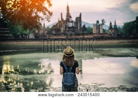 Young Woman Hipster Backpacker Traveling Into Wat Mahathat Temple In The Sukhothai Historical Park C