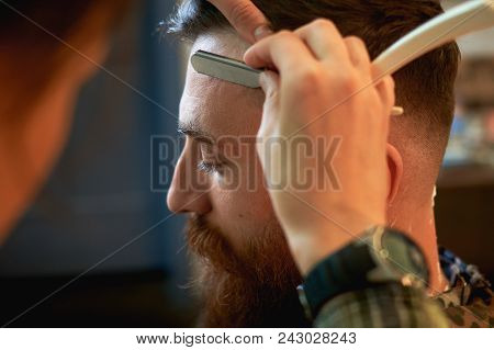 Close Up Of A Hairdressers Work For An Attractive Young Blond Man At The Barber Shop. He Is Doing St