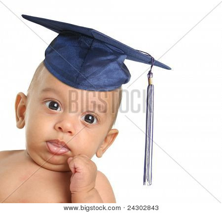 Three month old baby boy wearing a graduation mortar board.