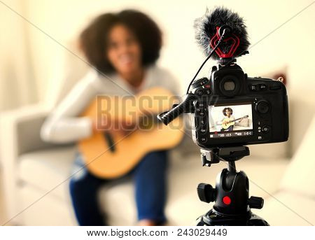 Female vlogger recording a music video